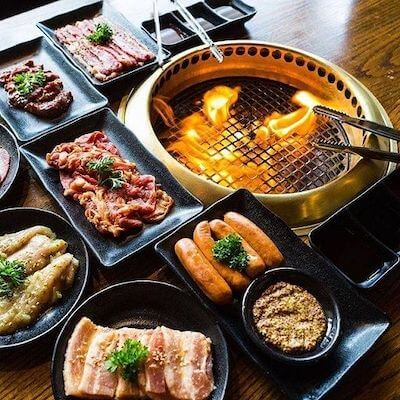Japanese barbecue with different types of meat next to a semi-open flame