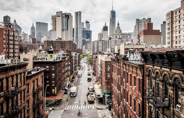 Wide view of the streets of Chinatown with the New York City skyline in the background