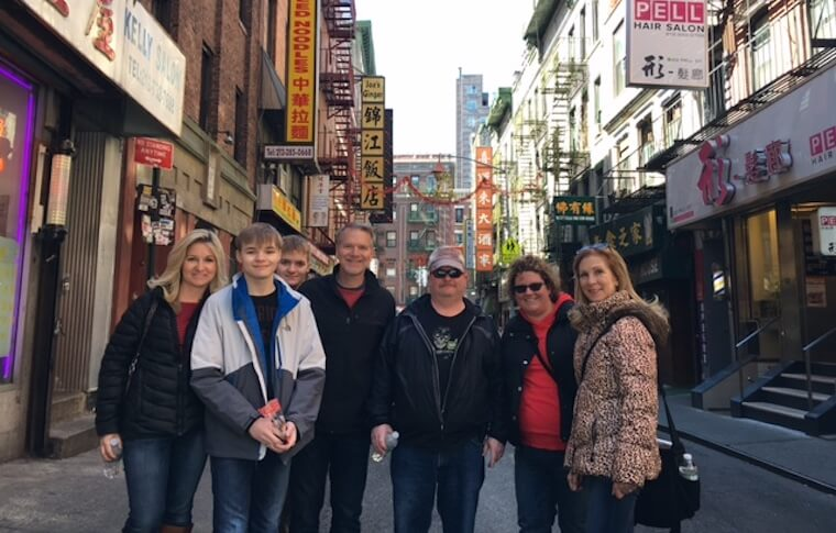 Group of six people posing on one of the streets in Chinatown