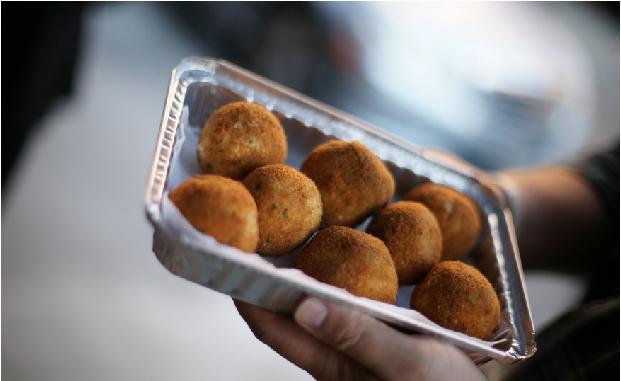 Eight rice balls in a metal tin
